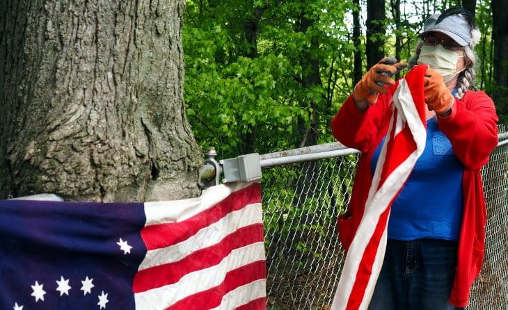 Despite Virus, Group Adorns Ellis Woods Cemetery